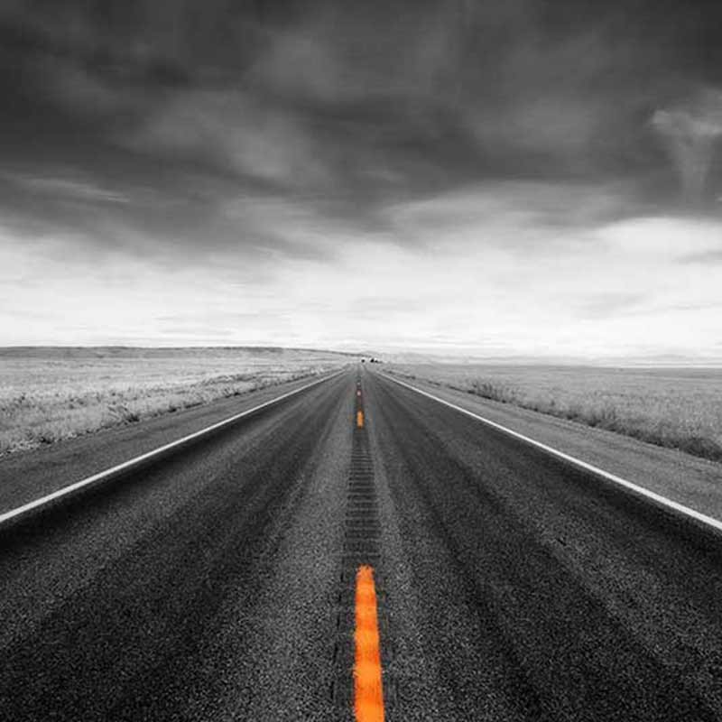 A grayscale image of a road with an orange line stretching forward to illustrate the tour of your WordPress backend that I can guide you on
